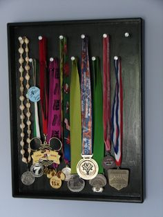 display medals - made this for my dad's running medals but with a cork board!  It turned out great! :-)