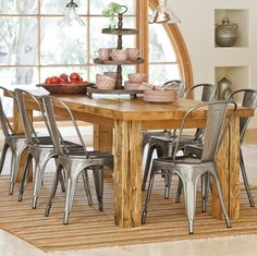 Love this farm-style dining room table and stainless steel chairs. I would probably put a bench on one side.