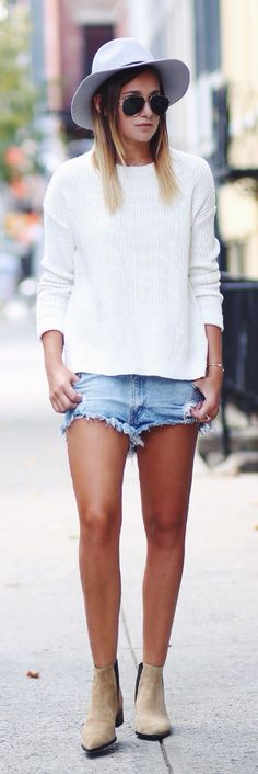 Danielle Bernstein is wearing a sweater from TopShop, denim shorts from One Teaspoon and boots from Acne