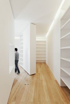 Pivoting wall and Storage. Casa da Escrita in  Coimbra, Portugal 2010/ Architect: João Mendes Ribeiro. Photographs: do mal o menos. #White #Closet