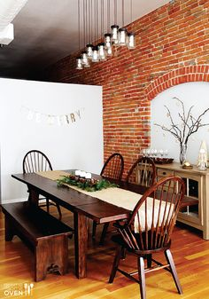 Giant wooden tables create a perfect kitchen remodel for family dinners. Love the wood stain color.