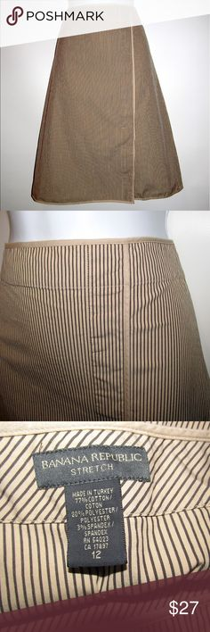 "Banana Republic Striped Pencil Skirt NWOT Classy Banana Republic striped pencil career skirt, Ladies size 12. Wrap look 9"" left front slit Left side zipper, hook & eye Measurements Length waist to hem: 23"" Width across front at waist: 15"" Width across front at hip: 21.5"" Fabric: 77% cotton/20% polyester/3% spandex  Garment care: Dry clean  From a smoke and pet free home Banana Republic Skirts"