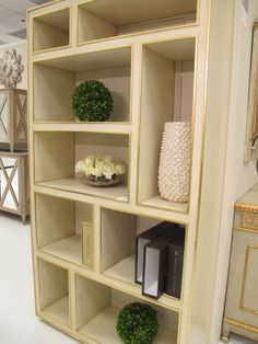 love the gold detailing and shapes of the shelves