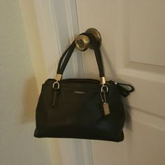 Authentic Coach handbag Small vintage leather coach purse. Has an adjustable shoulder strap attachment. Opening has a magnetic closure in middle with zipper closures on both sides. Gently used. Excellant condition. 6 inches tall 10 inches in length Coach Bags