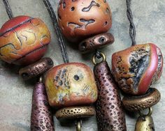 Rustic polymer clay bead and drop collection for earrings in rusty red, golden metallic bronze, and copper