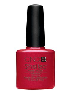 CND Shellac Gel Nail Polish in Hollywood. Salon polish only. Great coral red w/ tiny hint of sparkle. Wore it for 1 month w/ no chips or scratches. Dries instantly under salon UV light and stays hard and shiny. Even after a month it looked good. It would have lasted longer probably but my nails had grown so much the space between cuticle and polish had gotten too big and they were too long. I love the gel nail polish so much since I don't have to do my nails weekly but just once a month now.