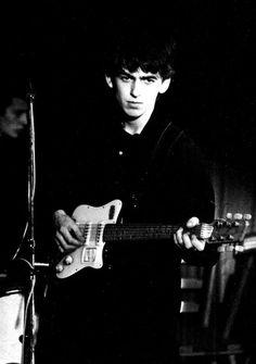 George Harrison playing at the Top Ten Club - Hamburg, 1961. Photo by Jürgen Vollmer.