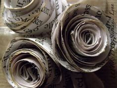 Book Page roses - how cute would these be for wedding decorations? and I would sheet music instead of book pages :)