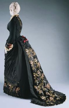 House of Worth mourning dress.  LIke the beading at front bottom, color and back train detail.