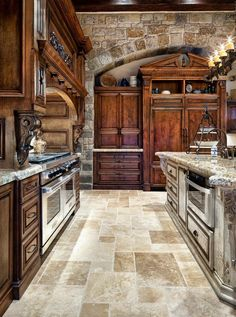Contrasting wall and island cabinetry with the same granite. Nice blending of materials.