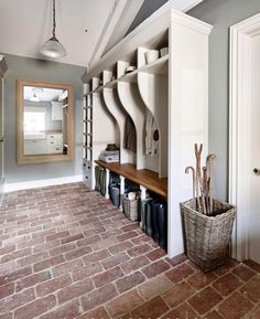 entrance contemporary house fitted with a custom white coat rack and . entrée maison contemporaine aménagée avec un portemanteau blanc sur mesure et… contemporary house entrance fitted with a custom white coat rack and paved pavement Rustic Laundry Rooms, Mudroom Laundry Room, Laundry Room Design, Kitchen Design, Mudrooms With Laundry, Mudroom Cubbies, Kitchen Ideas, Kitchen Decor, Miller House