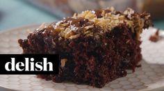 Samoa Poke Cake | Delish