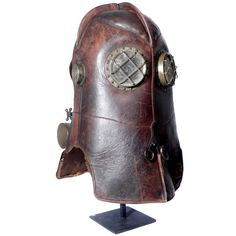 1800s Firefighters Rescue Respirator The Vajen Bader is considered the Holy Grial for fire rescue and industrial helmet collectors. A wire grid protects the large round nickel plated eye openings. The lenses are Mica to protect the wearer from heat. The ear plates are fitted with a perforated metal grill and are Mica lined.
