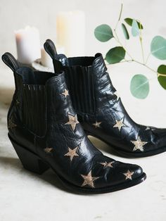 Reach For The Stars Ankle Boot | Western inspired pointy toe leather ankle boots featuring statement star accents and a stacked heel. Pull tab in back and elastic side inserts for an easy on/off.