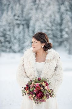 Fur Coat on Winter Bride | photography by http://brookebakken.com | floral, styling and event design by http://www.petalpixie.com