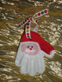 A Santa Ornament from a childs hand-print, made out of salt dough clay