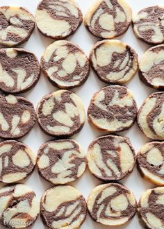 This recipe for Chocolate Vanilla Swirl Icebox Cookies makes tons of cookies that are perfect for holiday baking. They look beautiful and you can keep a roll in your fridge or freezer, ready to slice 'n bake!