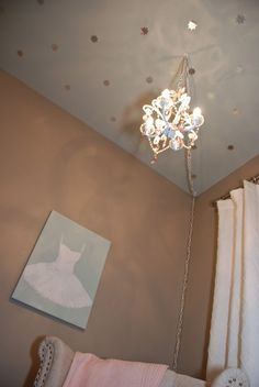 Metallic decals on the nursery ceiling - such a sweet, unexpected touch!
