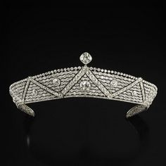 ART DECO DIAMOND TIARA c1920.  The band of slightly decreasing size surmounted by cushion-cut diamonds, worked with interspersed zig-zag waves in old-cut diamonds centered by large cushion-cut diamonds with a rigid support layer.
