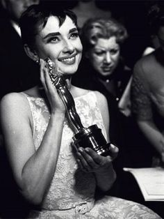 Audrey Hepburn holds her 1953 Oscar for Best Actress in Roman Holiday