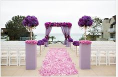 Such beautiful aisle decor featuring the hot wedding color for 2014! #radiantorchid