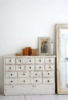 I love furniture that's made to look old and worn out like this =) tiny drawers in white