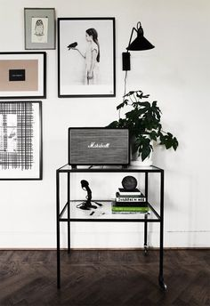 Monochrome console table styling - coffee table books, ornaments, radio, plant & love the framed art