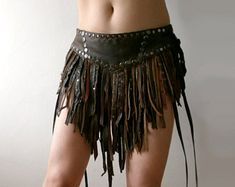 Dream Warriors brown leather skirt. Studded strap battle skirt. Post apocalyptic wasteland amazon mad max style burning man festival fashion