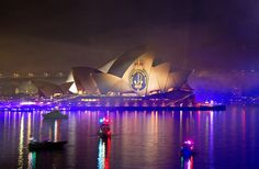 The Royal Australian Navy Crest is projected onto the Sydney Opera House during the International Fleet Review 2013 Pyrotechnics display and light show spectacular - Sydney, NSW.