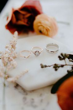 Elegant gold + silver wedding bands and a halo diamond engagement ring Engagement Ring Images, Halo Diamond Engagement Ring, Antique Engagement Rings, Silver Wedding Bands, Platinum Wedding, Wedding Rings, Before Wedding, Delicate Rings, Perfect Wedding