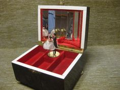 Vintage c1950s Red Celluloid music box with dancing lady & man