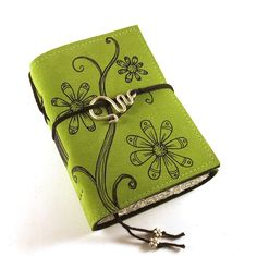 I've been admiring this shop for ages.  These are so lovely!  Leather Journal Handmade Spring Flowers by Kreativlink on Etsy, $49.00