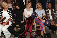 Best seats in the house: Taylor and Martha mugged for the cameras as they sat front row with Gigi's mom Yolanda and brother Anwar Hadid, left, and Formula 1 champ Lewis Hamilton, right
