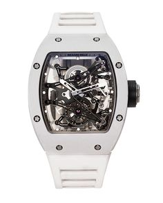 """Richard Mille's tonneau-shaped """"Tourbillon Prototype"""" magnesium watch (Ref. RM038 AL MG PROTO 03). The extremely rare timepiece, with a magnesium-alloy case, features a visible one-minute tourbillon regulator, a 48-hour power reserve, and titanium, double-folding deployant clasp. Estimated at 2,000,000 – 3,000,000 HKD in Antiquorum's 40th anniversary auction on Feb 22, 2014."""