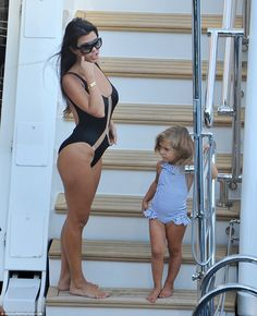 Family trip: Kourtney's daughter Penelope wore a cute striped swimsuit with…