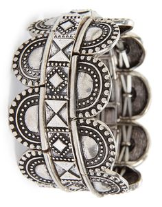 Three stretchy bangle bracelets feature a geometric design and an antiqued finish. Stack them or wear them separately to create a custom boho look.