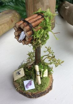 Fairy Mailbox and Letters Handcrafted by Olive ~ Includes tiny mail, letters, scrolled letter tied with beaded fastener Fairy Not Included, Other Listing Includes Fairy **** Also available in Mini~Mini size for small scale terrarium and extra small scale gardens! Mini~Mini Size