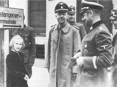 Heinrich Himmler visiting a concentration camp along with his daughter Gudrun & Nazi entourage, around 1941.