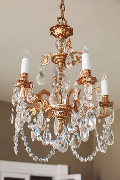Don't spend a fortune on a trendy, new copper chandelier; give an old chandelier new life with a good wash, a coat of paint, and some fresh bling. There are plenty of candidates on Craigslist just waiting for their chance at makeover glory.