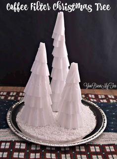 Check out this super cheap and cute Coffee Filter Christmas Tree idea!  It glows in the dark!!!