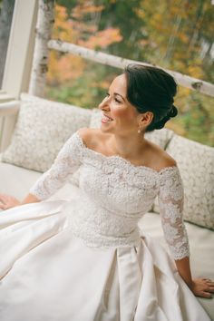 Love the lace sleeves on this wedding gown! More of the wedding on SMP: http://www.StyleMePretty.com/2014/02/10/fall-hidden-pond-maine-wedding/  Emily Delamater