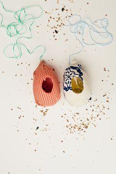 Plastic egg bird feeders from left over eggs.