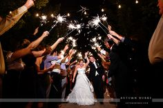 Brides are oftentimes concerned with their wedding dress being damaged by sparklers. This picture perfectly demonstrates there is very little to fear, and we couldn't be happier! Purchase yours today! #weddingsendoff #weddingexit #sparklerexit #sparklersendoff #weddingsparklers #weddingproducts #weddingpictures