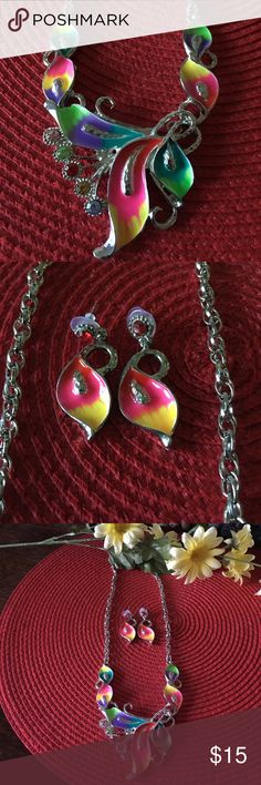 "Fashion Jewelry Set Condition: New without tags's/packaging, received his gift and have never worn. Colors: Silver, pink, green, blue, yellow, purple, red Style: multicolored floral gem fashion set Features: Different vibrant colored matching earrings and necklace set Material(s): Mixed metals and gems Care: n/a Measurements: 🔹16-20"" adjustable necklace, 1.5"" earrings Amazon Jewelry"