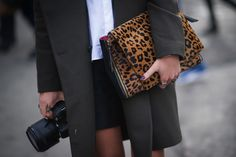 Best Street Style Shoes and Bags NY Fashion Week Fall 2014 ----  Get Up Close With Street Style's Best Accessories >>> Double-fisting two Fashion Week essentials: a camera and a chic clutch.