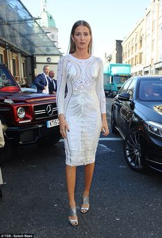 Wow thing: She's known for her love of fashion and Millie Mackintosh pulled out all the stops to attend the star-studded Julian Macdonald show on Saturday, as part of London Fashion Week