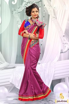 Embellished with lace patti, resham and embroidery works. The bhagalpuri and dhupion made pink red designer party wear Saree is attractive in looks.