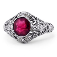 The Alora Ring--an antique platinum ring with a bold 2.11 ct. round bezel-set ruby embraced by intricate vining filigree, diamonds and delicate milgrain.