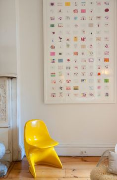 I love the idea of shrinking your child's artwork and displaying it like this. Shows changes over time or a range of subjects or just a fun mix of styles and colors!