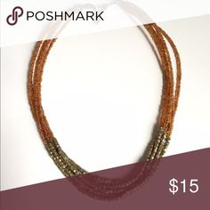 Lia Sophia Multi-strand Necklace Lia Sophia gold and orange beaded multi-strand necklace with lobster claw clasp. Lia Sophia Jewelry Necklaces